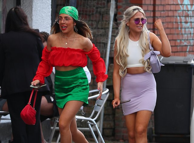Revellers arrive at Circus nightclub in Bramley-Moore Dock, Liverpool, for a Covid safety pilot event