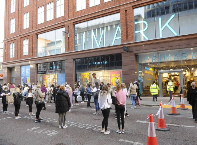 Shoppers queue outside Primark in Belfast as shops reopen and hospitality is able to open outdoors in Northern Ireland