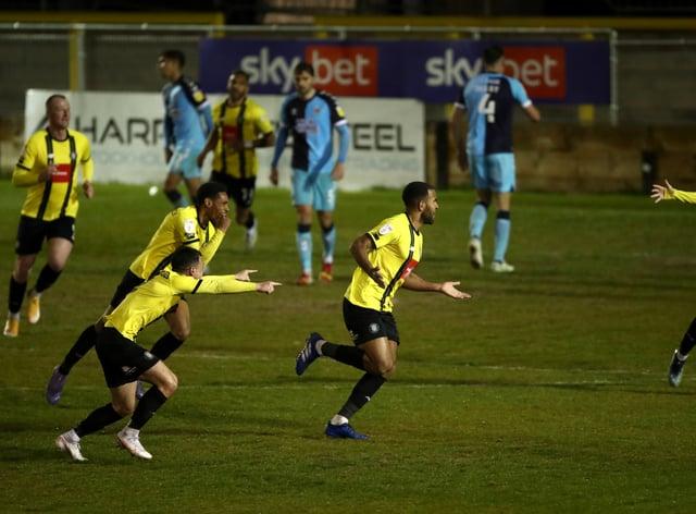 Harrogate's Kevin Lokko celebrates scoring