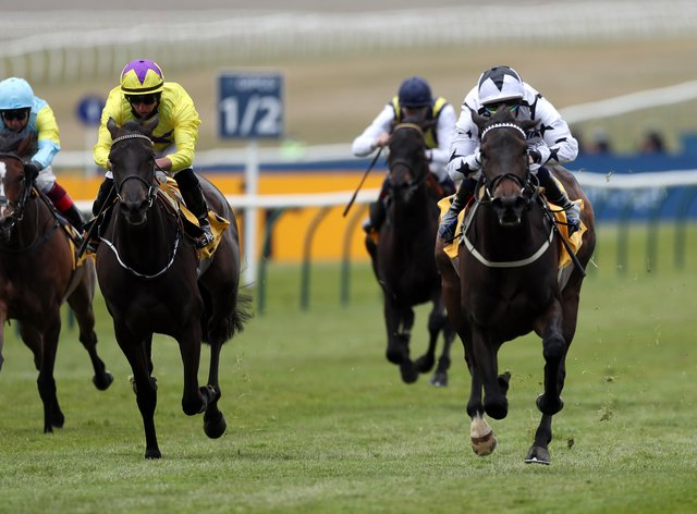 Mystery Angel (right) takes the Betfair Pretty Polly Stakes in the hands of Ben Curtis
