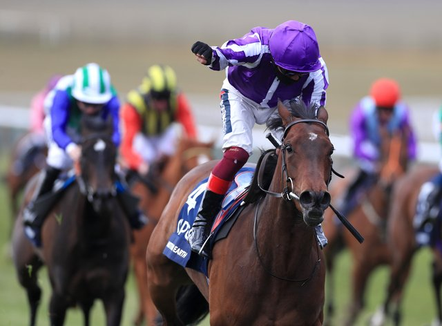 Mother Earth lifts the Qipco 1000 Guineas at Newmarket in the hands of Frankie Dettori