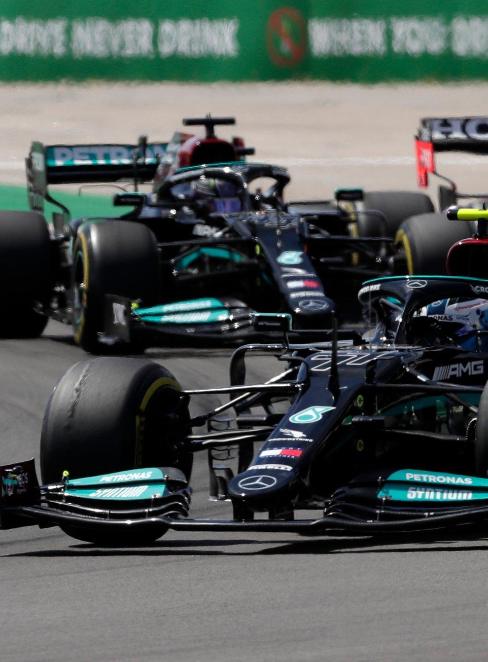 Hamilton (left) got the better of Bottas and Verstappen