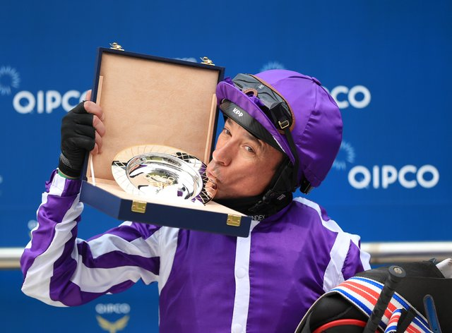 Frankie Dettori kisses the trophy after winning the Qipco 1000 Guineas