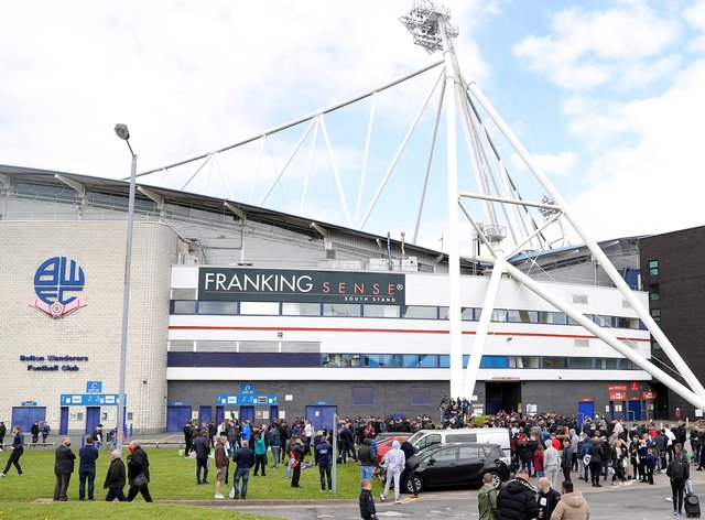 Bolton Wanderers fans gather outside the ground