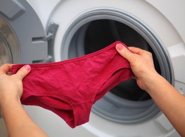 Woman holding underwear