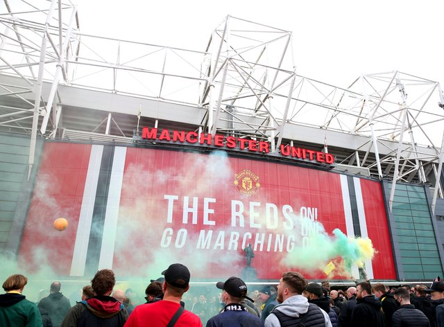 Fans let off flares as they protest against the Glazer family, the owners of Manchester United