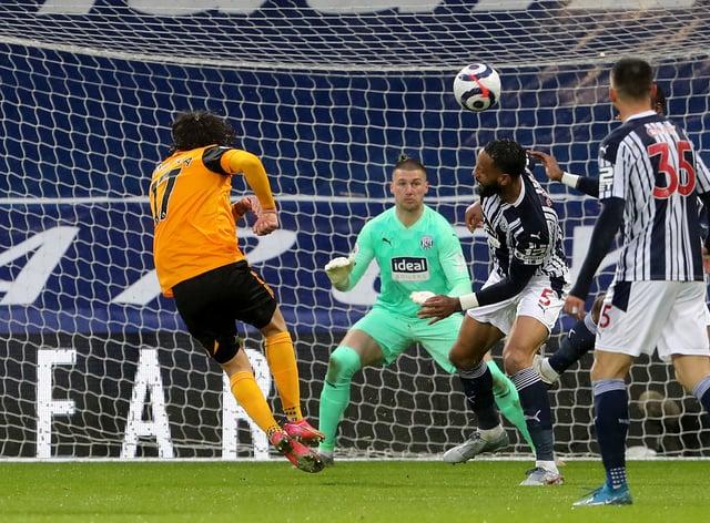 Fabio Silva (left) opens the scoring for Wolves