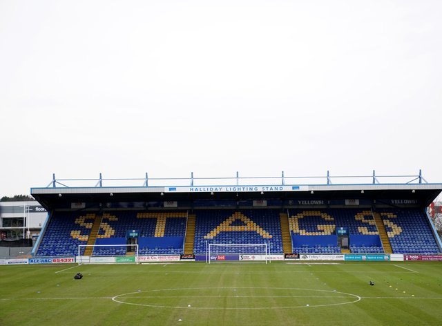Mansfield have signed three academy players to professional deals