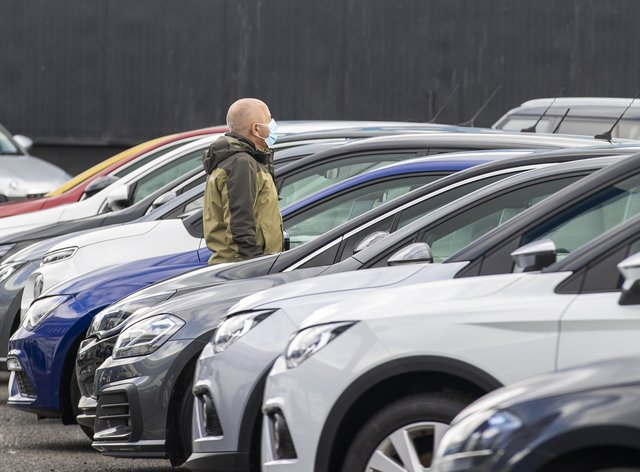 A customer looks at cars