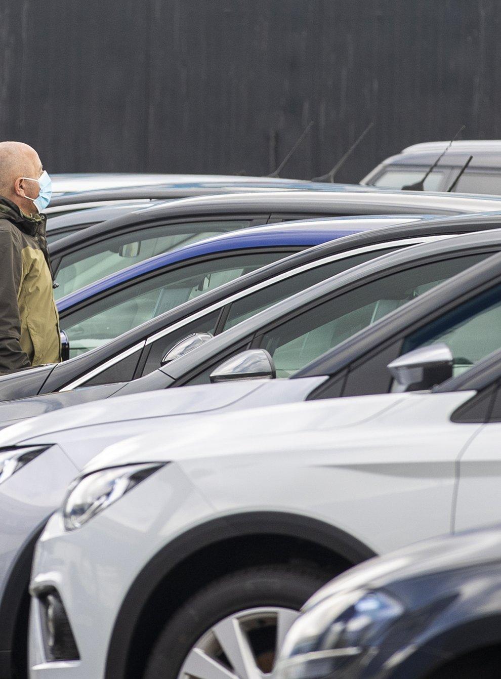 A customer looks at cars