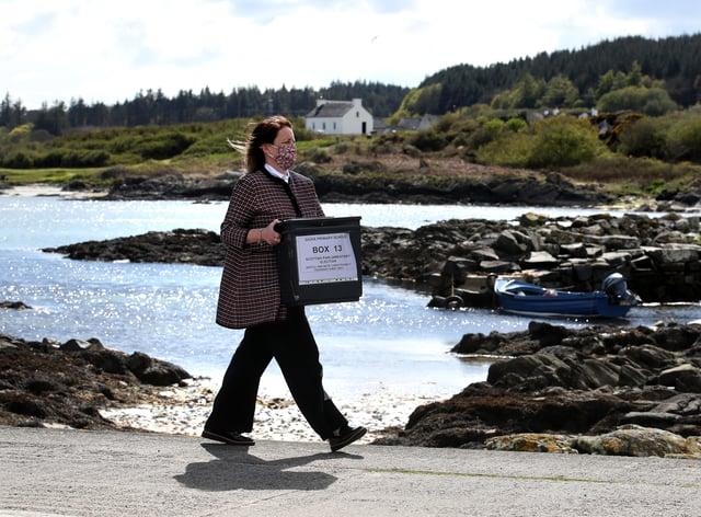 Woman carries ballot box