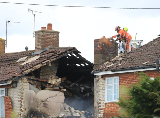 Firefighters inspect damage to a property in Mill View in Willesborough, near Ashford, Kent (Gareth Fuller/PA)