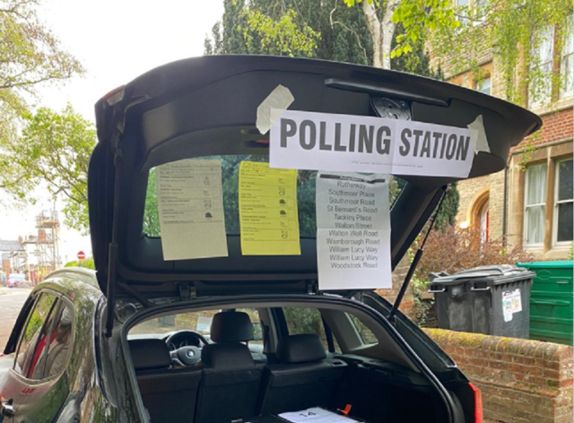 Temporary polling station in a car boot