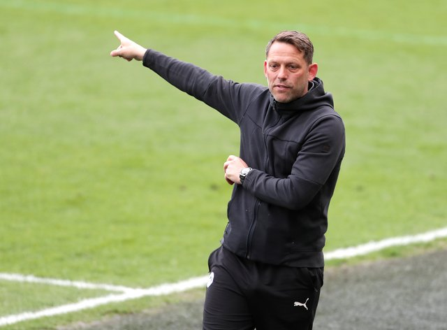Wigan manager Leam Richardson points on the touchline