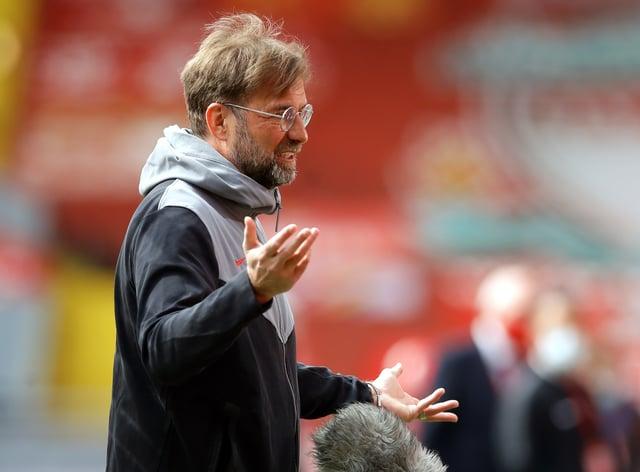 Liverpool manager Jurgen Klopp conducts a pitchside interview