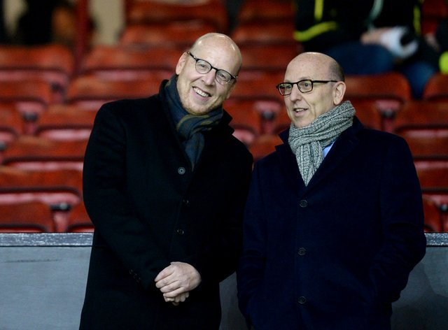 Manchester United co-chairman Joel Glazer, right, has written a letter to the club's supporters