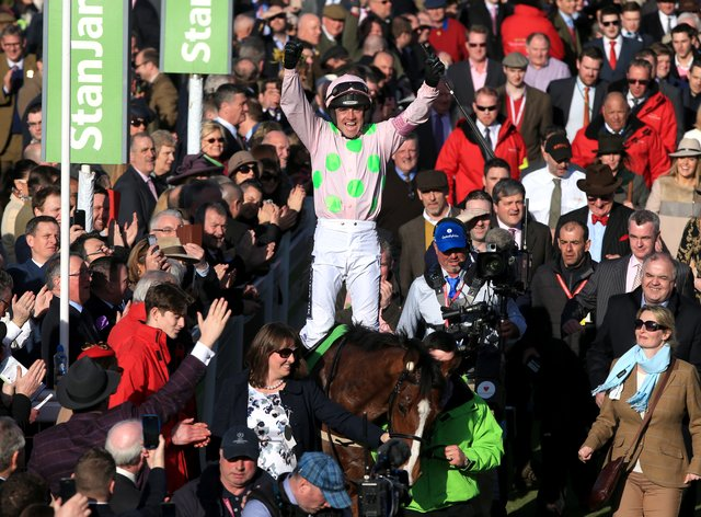 Ruby Walsh celebrates winning the Champion Hurdle with Faugheen