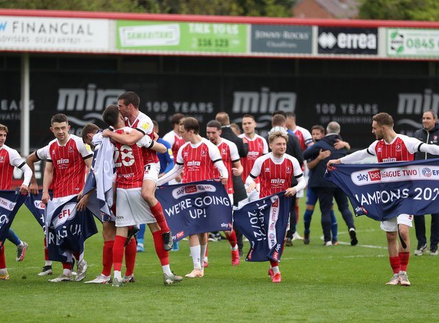 Cheltenham's players celebrate becoming League Two champions