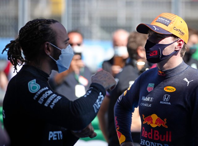Lewis Hamilton (left) talks with Max Verstappen after qualifying
