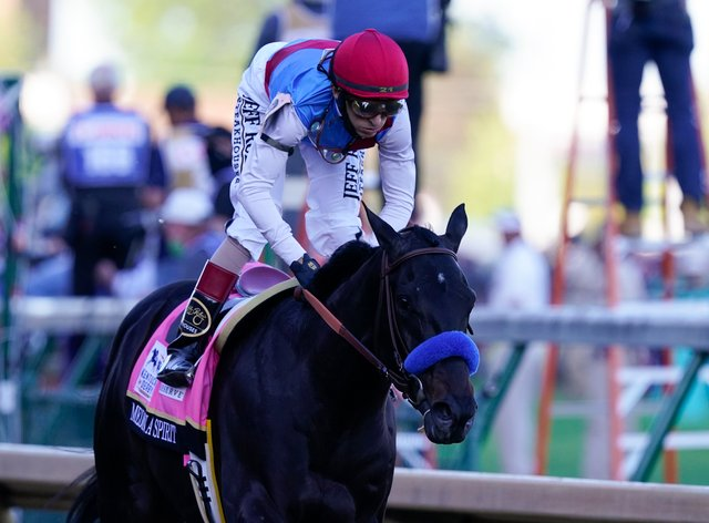 John Velazquez rides Medina Spirit to victory in the 147th running of the Kentucky Derby