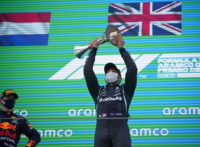 Lewis Hamilton celebrates on the podium after winning the Spanish Grand Prix