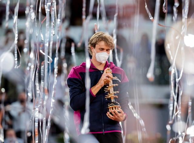Alexander Zverev celebrates with the Madrid Open trophy