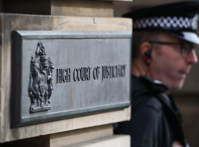 A policeman outside the High Court in Edinburgh