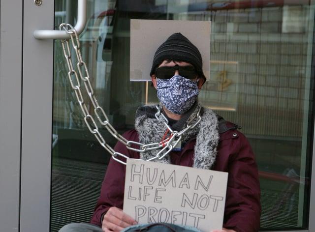 Protesters gathered outside AstraZeneca's HQ in Cambridge
