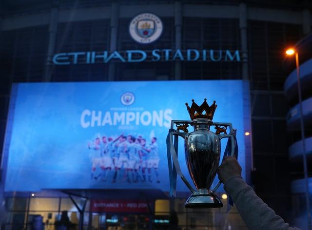 Manchester City fans celebrate the club's Premier League triumph at the Etihad Stadium