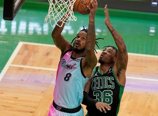 Miami Heat's Trevor Ariza (8) drives to the basket as Boston Celtics' Marcus Smart tries to block