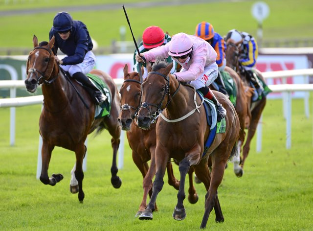Passion (left) in the Juddmonte Irish Oaks at the Curragh