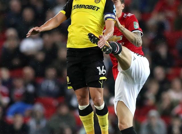 Luke Varney (left) in action for Burton