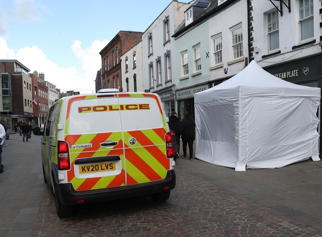 A police tent outside The Clean Plate cafe in Southgate Street, Gloucester
