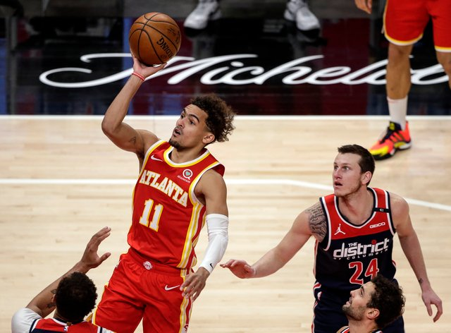Atlanta Hawks guard Trae Young puts up a shot against the Washington Wizards