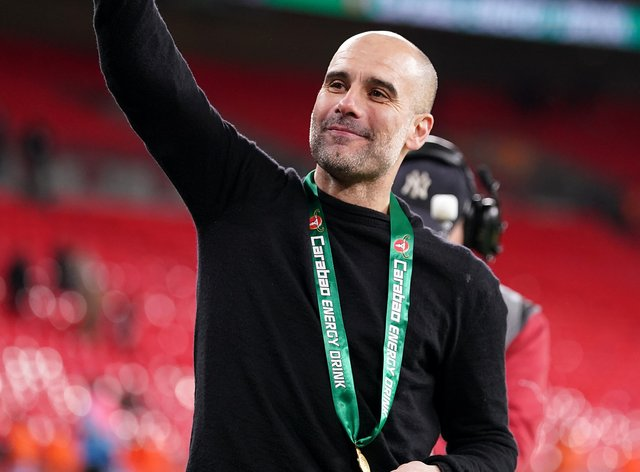 Pep Guardiola punches the air in delight