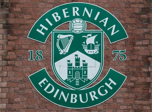 A Hibernian badge on a wall at Easter Road