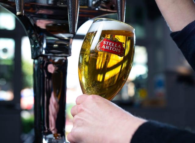 A bar worker pulls a pint