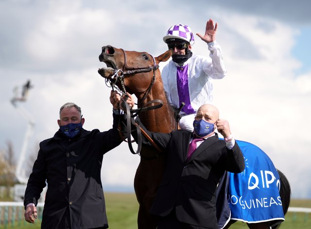 Poetic Flare and jockey Kevin Manning were narrow winners of the Qipco 2000 Guineas at Newmarket
