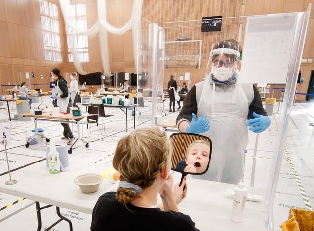 Woman takes coronavirus test