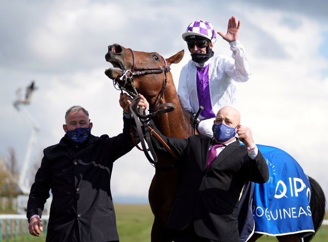 Jockey Kevin Manning celebrates winning the Qipco 2000 Guineas on Poetic Flare