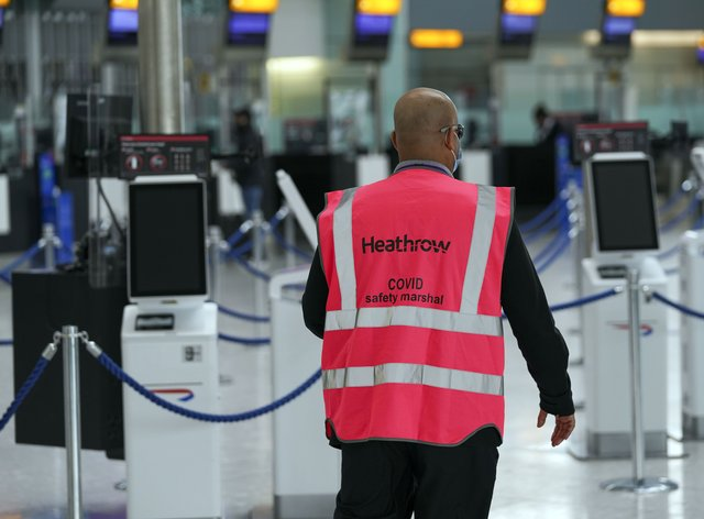 Heathrow Covid marshall patrols the airport