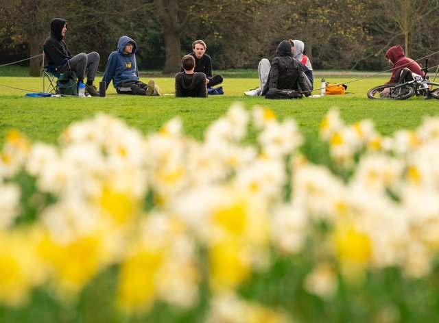 People observe social distancing as they meet up in Greenwich Park