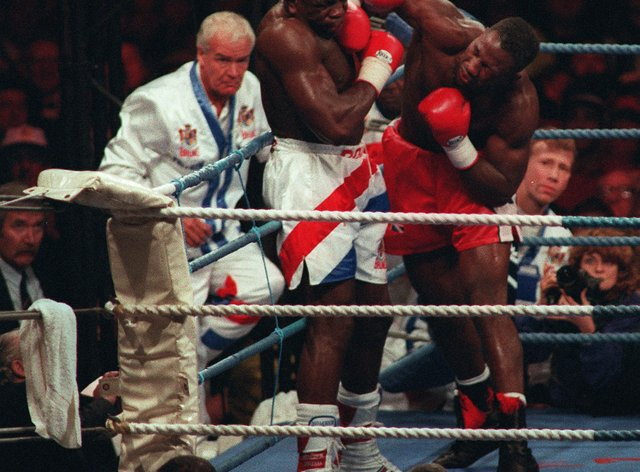 Lennox Lewis defeats Frank Bruno in Cardiff in October 1993