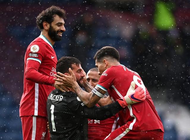 Liverpool goalkeeper Alisson Becker celebrates scoring