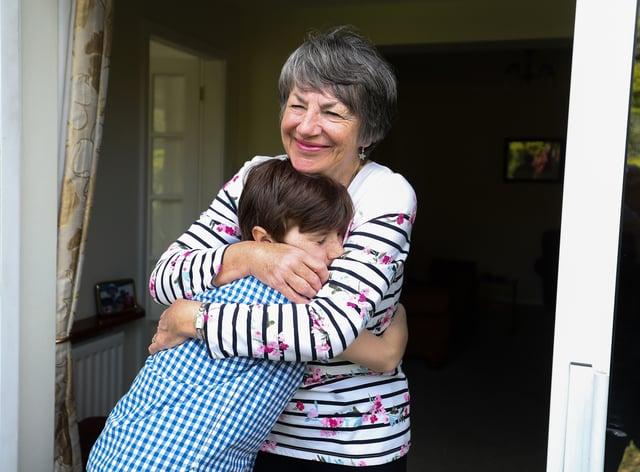 Relatives hug
