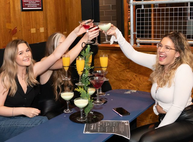 Rosie Delaney, Isobel Logan and Rebecca Mitchell enjoy their first drink inside the Showtime Bar in Huddersfield, West Yorkshire, as indoor hospitality and entertainment venues reopen to the public following the further easing of lockdown restrictions in England