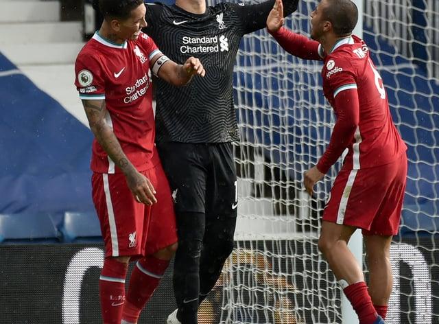 Liverpool goalkeeper Alisson celebrates with Roberto Firmino (left) and Thiago Alcantara