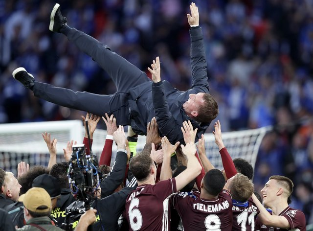 Brendan Rodgers was thrown into the air by his Leicester players after their FA Cup triumph