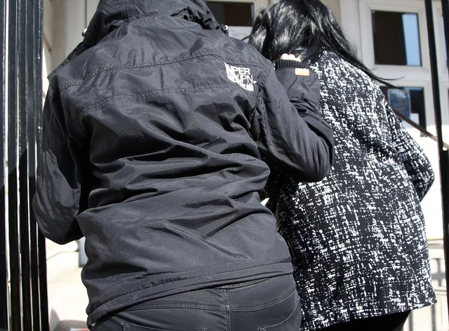 Jennifer Johnson (right) the ex-girlfriend of Babes in the Wood murderer Russell Bishop, is bundled into Lewes Crown Court (Gareth Fuller/PA)
