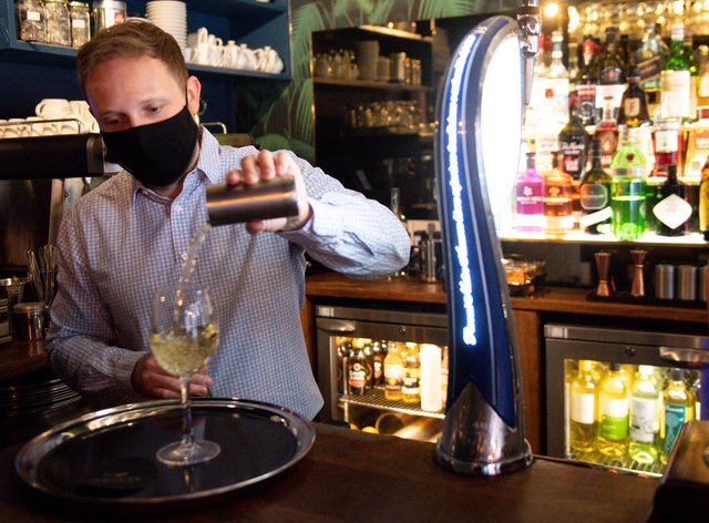 A man pours a drink